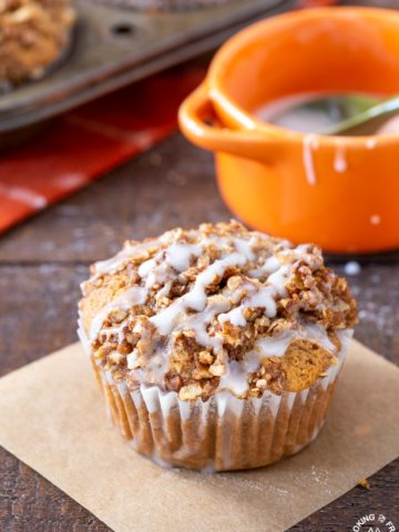 A pumpkin muffin sitting on a board