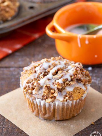 A pumpkin muffin sitting on a board