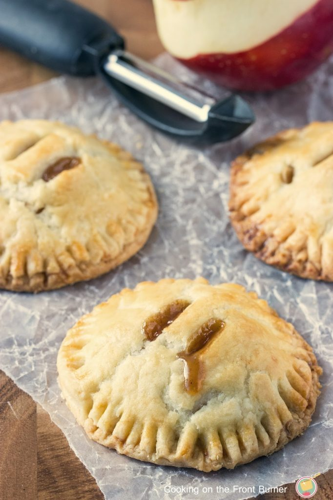 Apple Hand Pies are handheld versions of classic apple pie. Easy to make, this is the perfect snack or dessert recipe! | Cooking on the Front Burner