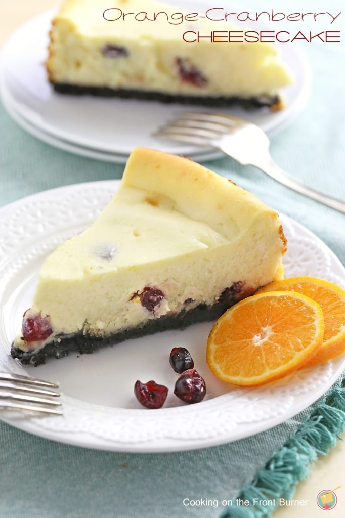 A creamy cheesecake with flavors of orange and cranberries - perfect for your dessert table | Cooking on the Front Burner