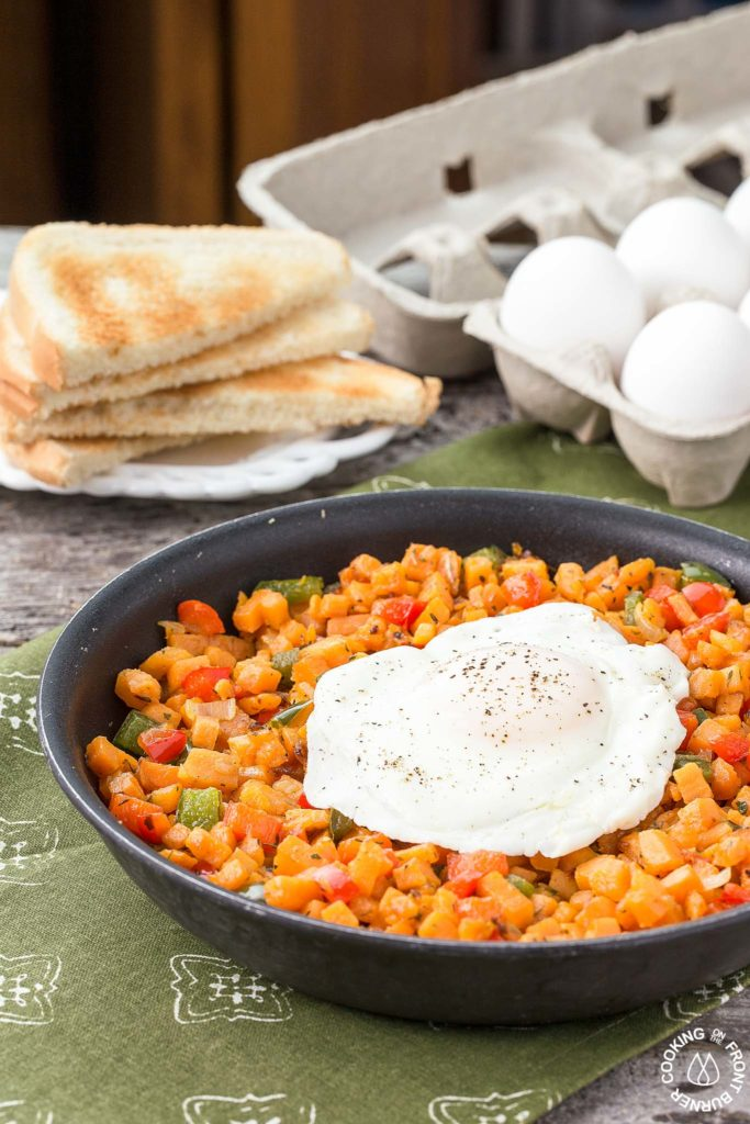 Sweet Potato Hash with egg in a skillet