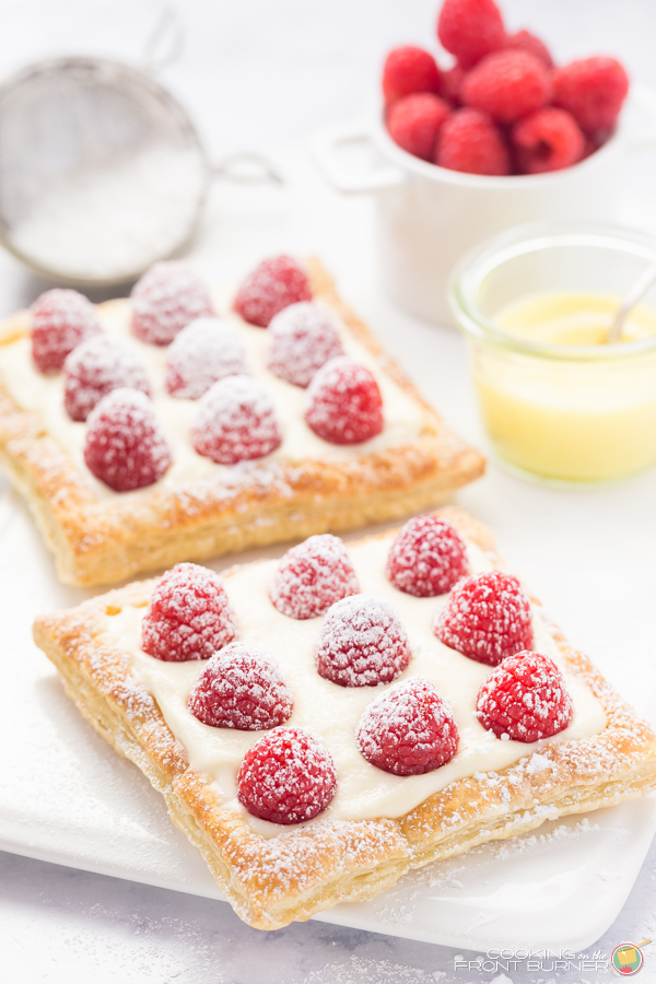 Lemon Raspberry Tarts for Two is the perfect dessert recipe to share with someone special! Flaky pastry, creamy lemon filling and fresh raspberries!
