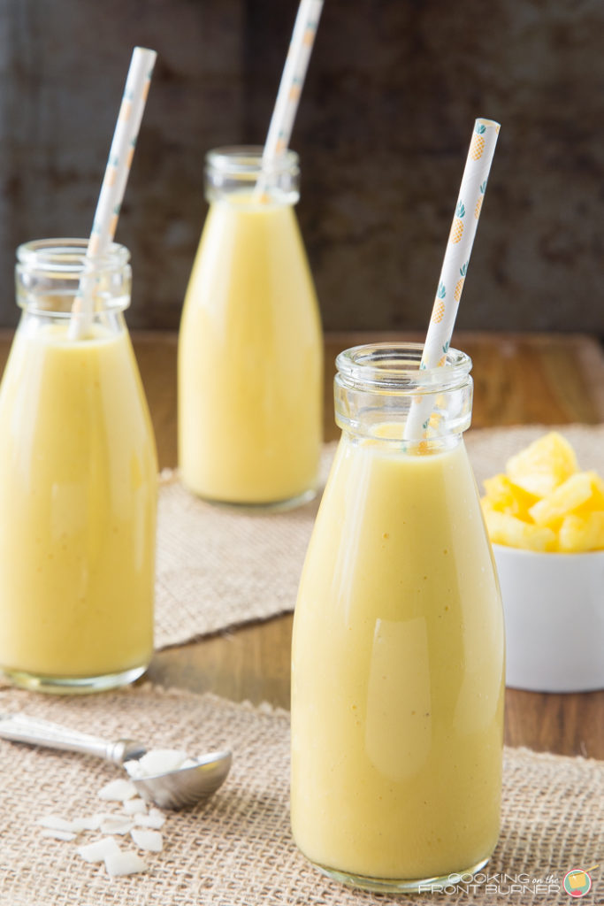 One sip of a pineapple coconut mango smoothie, with its tropical fruit flavors, will help you feel like you've been whisked away to a tropical island resort! This easy smoothie recipe is so refreshing!