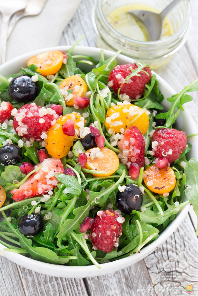 Quinoa salad with fresh berries, arugula, and orange poppy seed vinaigrette makes the perfect healthy dinner!