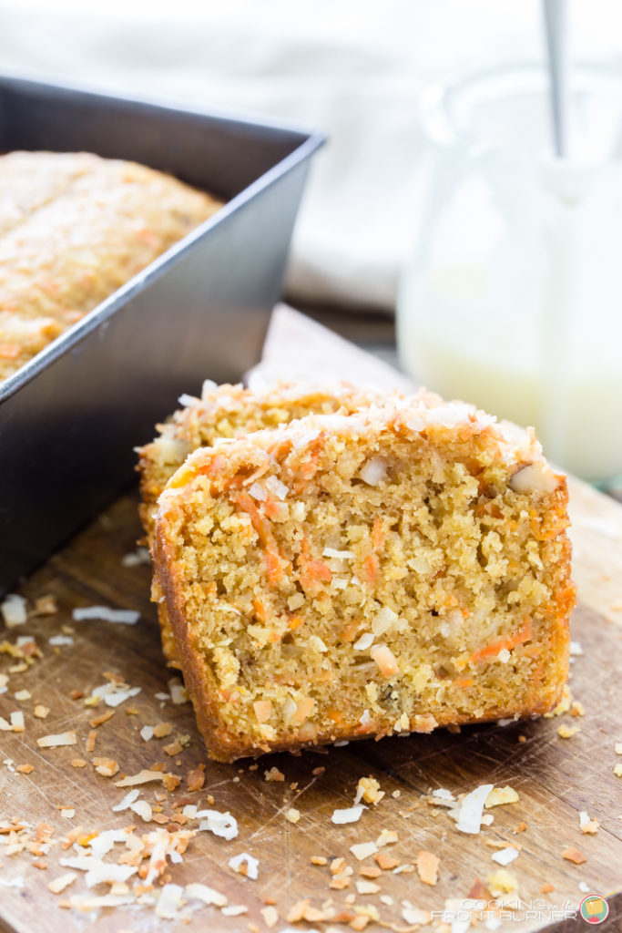 Carrot coconut bread - This super quick and easy Carrot Coconut bread is loaded with carrots, coconut, walnuts with a creamy glaze and topped with toasted coconut. Perfect for breakfast, Easter and when company calls!