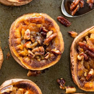 These Smashed Sweet Potatoes are the perfect side dish for any occasion. The sweet potatoes are roasted with cinnamon, a bit of chili powder and topped with toasted maple pecans!
