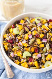 This Butternut Squash and Wild Rice Salad starts with roasted squash and Minnesota wild rice then tossed with crunchy celery, sweet dried cranberries, pumpkins seeds and drizzled with a maple walnut vinaigrette.  Perfect for fall, holidays or any time!