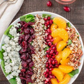 This Chopped Spinach Winter Salad is a healthy, flavorful side dish. You will especially love the freshly made cranberry and orange vinaigrette!