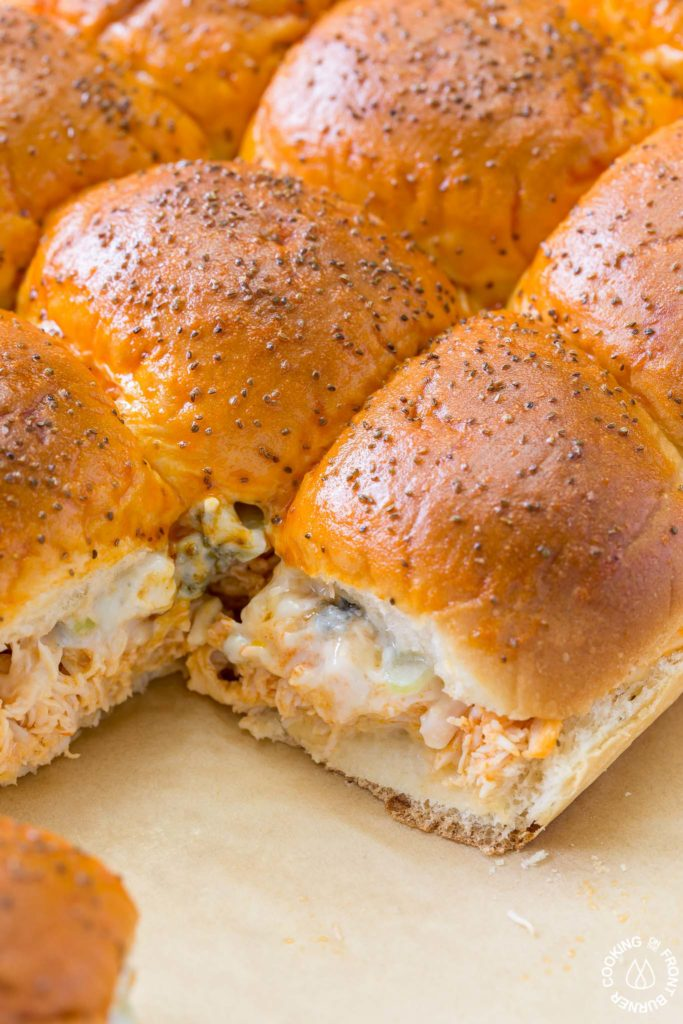 Your game day will be kicked up a notch with these Easy Buffalo Chicken Sliders! The perfect party size sandwich with the right amount of spice, creamy blue cheese and some crunchy celery.