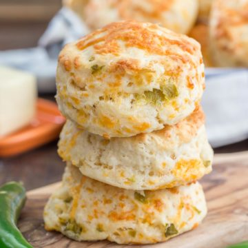 These Green Chile Cheddar Biscuits are perfect with a bowl of your favorite soup or chili. They are light, fluffy and kicked up a notch with green chilies. Eating them plain too is a good idea!