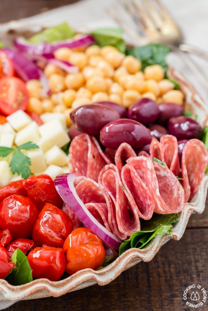 You will love this easy recipe for Italian Antipasto Salad that is loaded with veggies, meat, cheese and a lemon vinaigrette dressing. Make it big for a main course or smaller for side salads. #antipasto #italian #salad