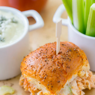 Your game day will be kicked up a notch with these Easy Buffalo Chicken Sliders! The perfect party size sandwich with the right amount of spice, creamy blue cheese and some crunch celery.