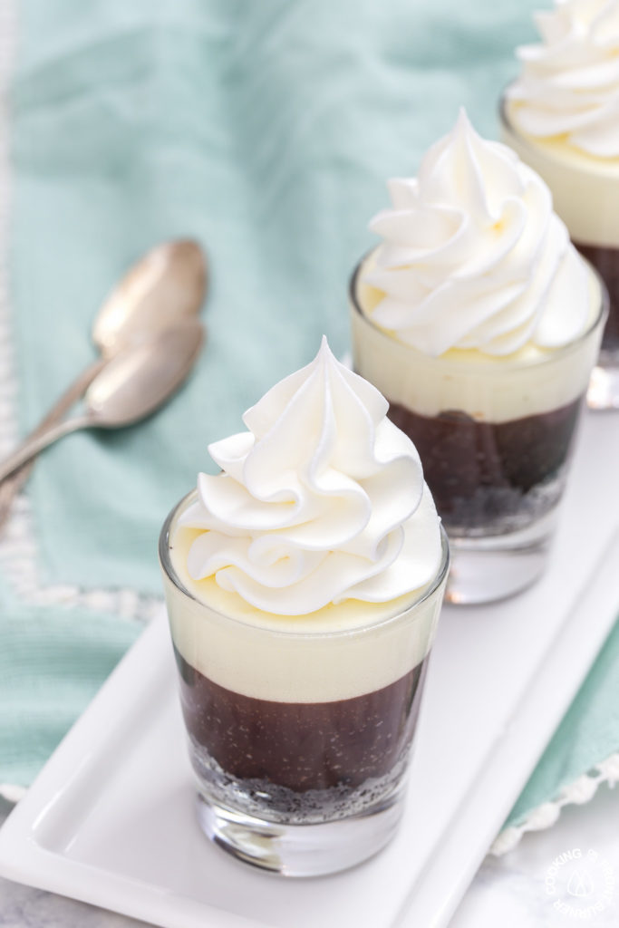These no-bake Double Chocolate Mousse Shooters make the perfect mini dessert.  They have an chocolate crumb crust, a dark chocolate truffle layer then topped with a creamy white chocolate mousse.  You can even have more than one, I'll never tell!