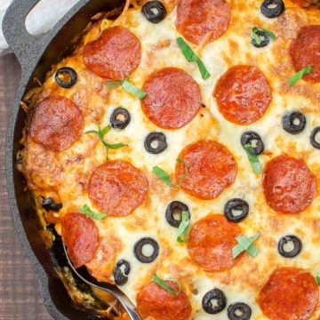 In 30 minutes you can serve this Pizza Tortellini Skillet Casserole on the family table. Talk about freaky fast and delicious! It's a very comforting dish with tender cheese pasta, a rich marinara sauce, pepperoni, olives and two kinds of cheeses and all baked in one skillet! #skillet #pasta #casserole