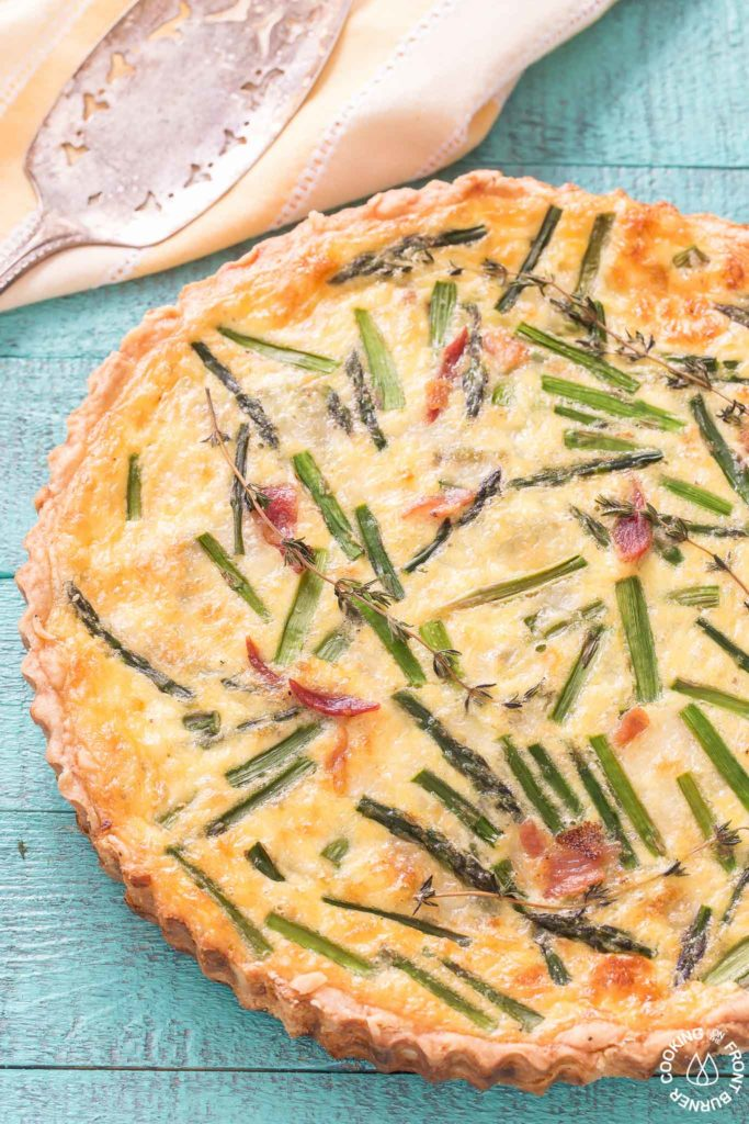 close up picture of asparagus and leek quiche