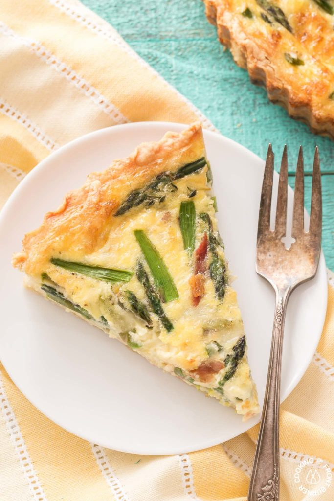 quiche on a plate with fork