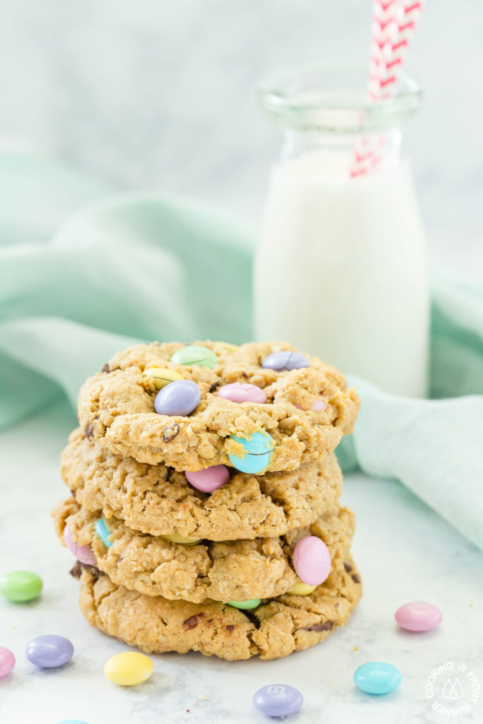 stack of easter monster cookies with milk