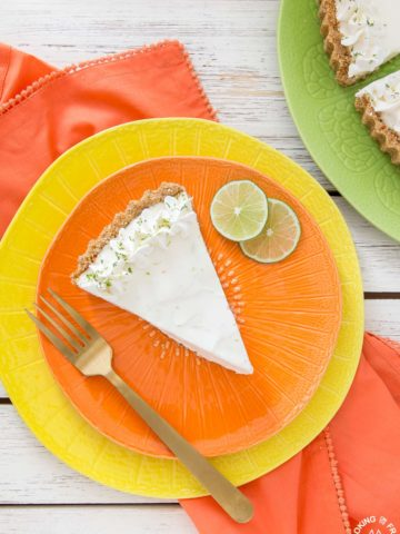 Light and refreshing describes this no-bake Frozen Margarita Tart.  You will love the creamy whipped texture with fresh lime juice, lime zest, triple sec, tequila mixture all piled into a salty pretzel crust.
