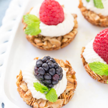 These bite sized Fruit Yogurt Granola Bites would be a great addition to your Mother's Day brunch table.  Use your favorite yogurt on top of the crunchy oatmeal and honey tart shell then add fresh fruit berries to finish it off!