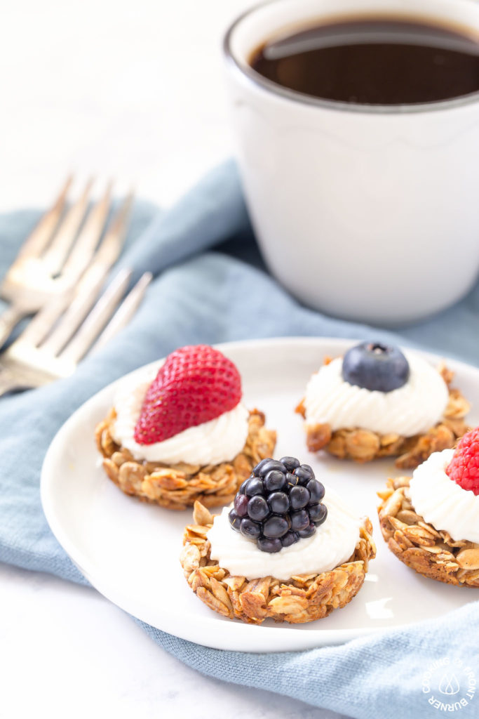 coffee with berry tarts on a plate