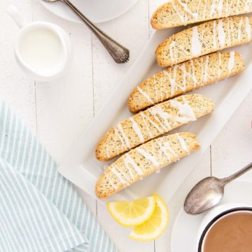 Grab a cup of coffee, a latte or some espresso (or even tea) to enjoy this Lemon Poppy Seed Biscotti to dunk this crispy and lemony treat in.  Enjoy them for breakfast, snack time or any time you have a craving for a tasty treat! #biscotti #lemon #poppyseed #breakfast