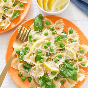 You will love how light and tasty this Springy Lemon Bow Tie Salad is with tender peas, fresh basil, bow tie shaped pasta, tangy parmesan cheese and spritzed with freshly squeezed lemon juice and tossed in olive oil.  It makes a great dish to any meal and can be whipped up in no time!