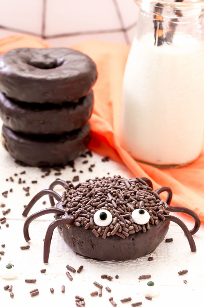 Chocolate spider donut with a glass of milk