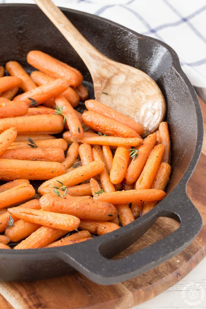 cast iron skillet with carrots on a trivet