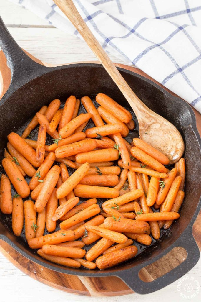 roasted carrots in a cast iron skillet