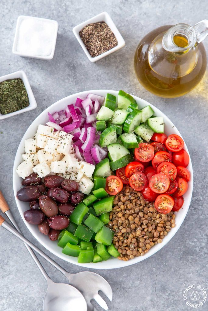 lentils and greek salad in a bowl