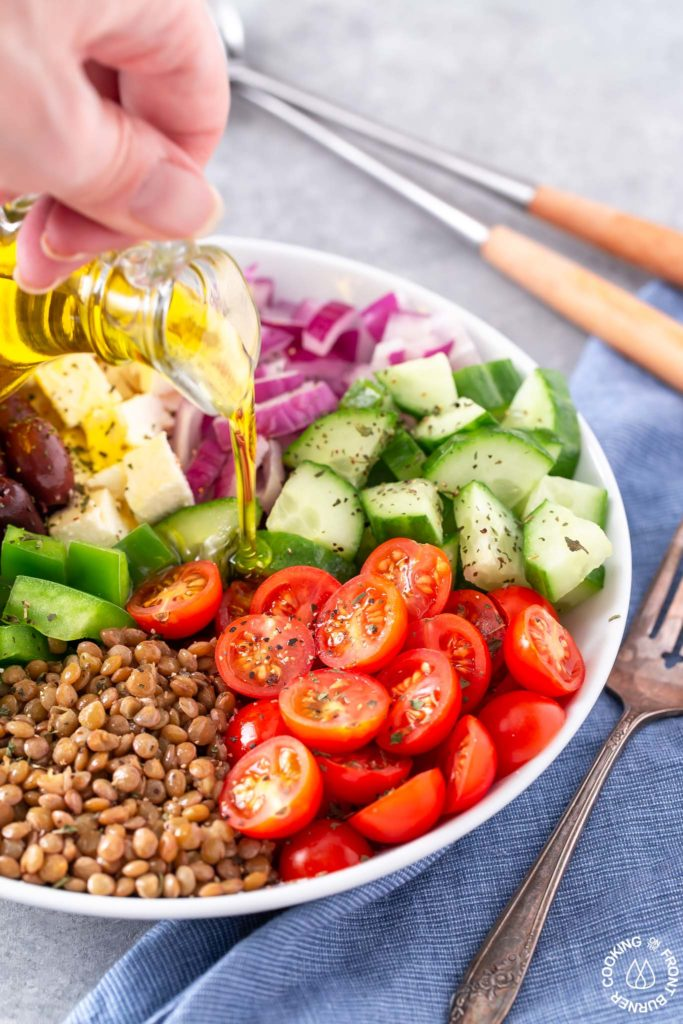 olive oil drizzled on a greek salad
