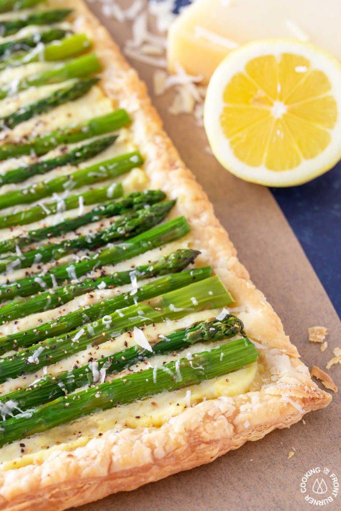 close up shot of asparagus tart on parchment paper