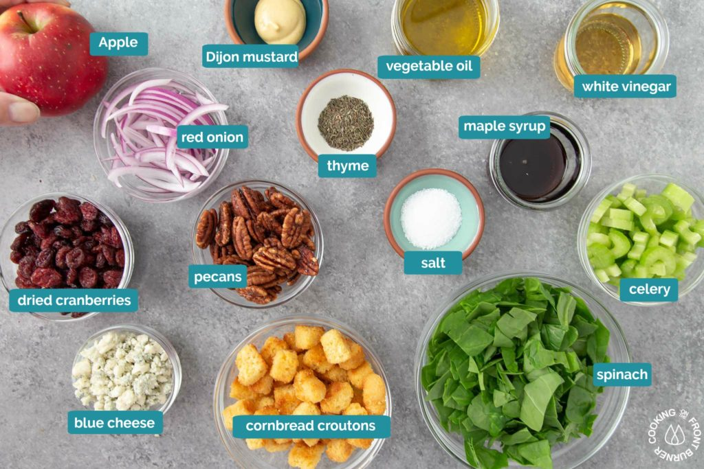 a picture will all ingredients needed to make spinach salad with maple vinaigrette dressing