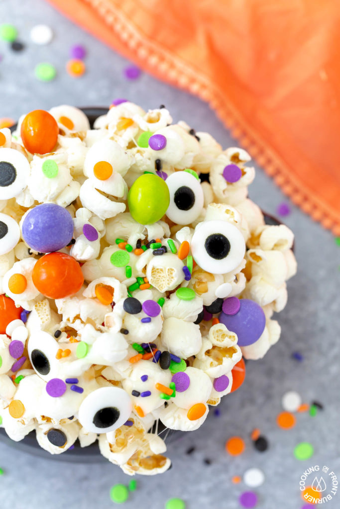 a close shot of a bowl of halloween snack mix
