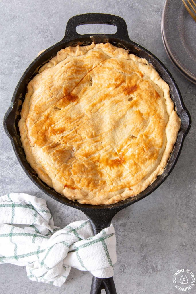 a baked chicken pot pie in a cast iron skillet