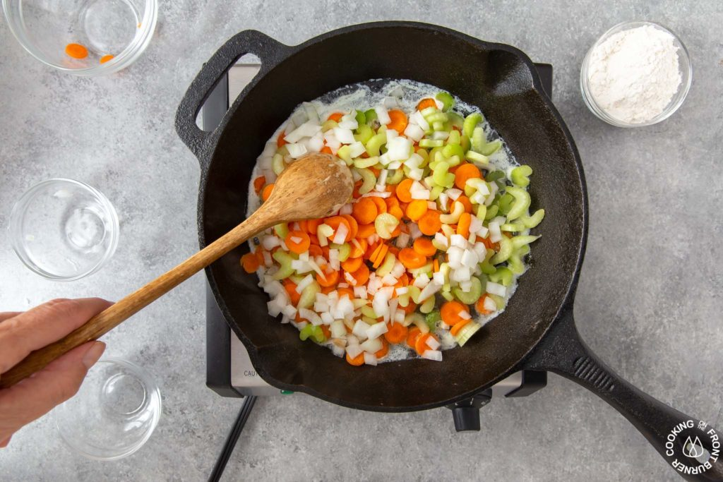 sauteing veggies in a skillet for pot pie