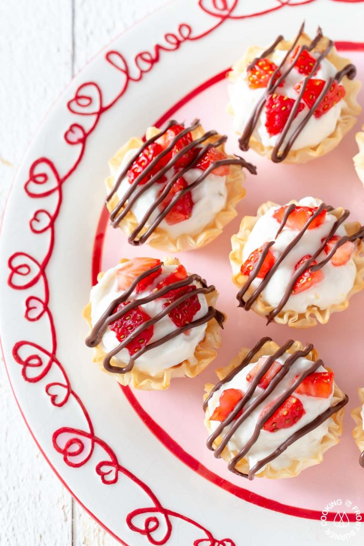 mini cheesecake bites in phyllo cups on a plate