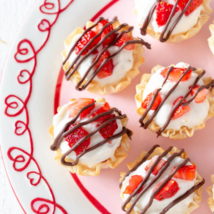 strawberry cheesecake phyllo cups on a plate