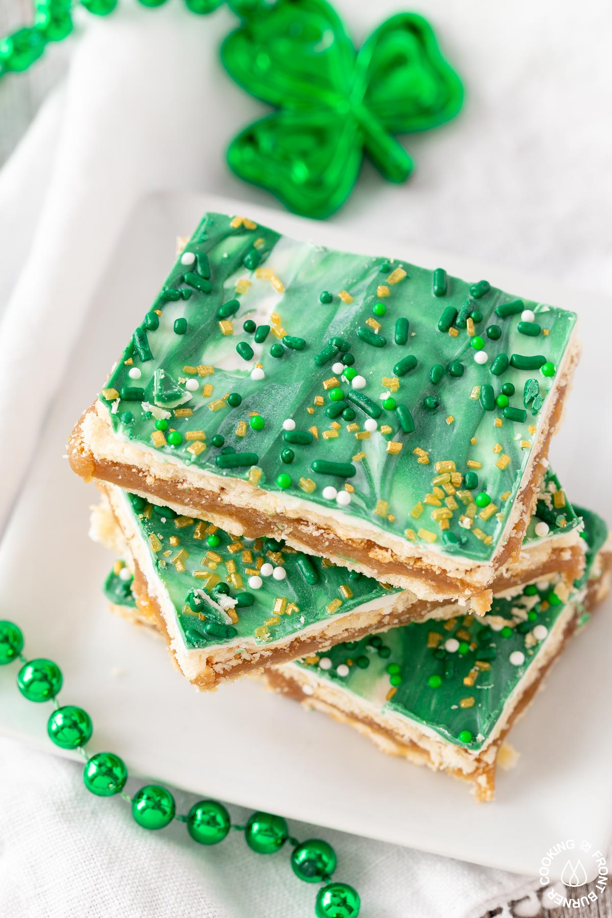 A plate with st patrick club cracker bars on it