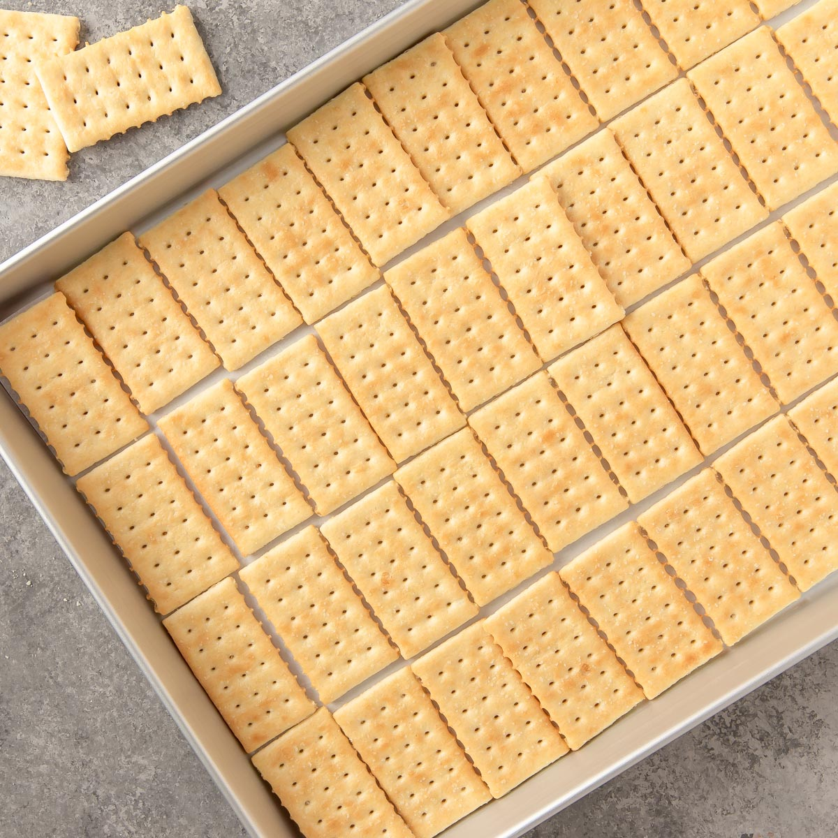 a jelly roll pan lined with crackers