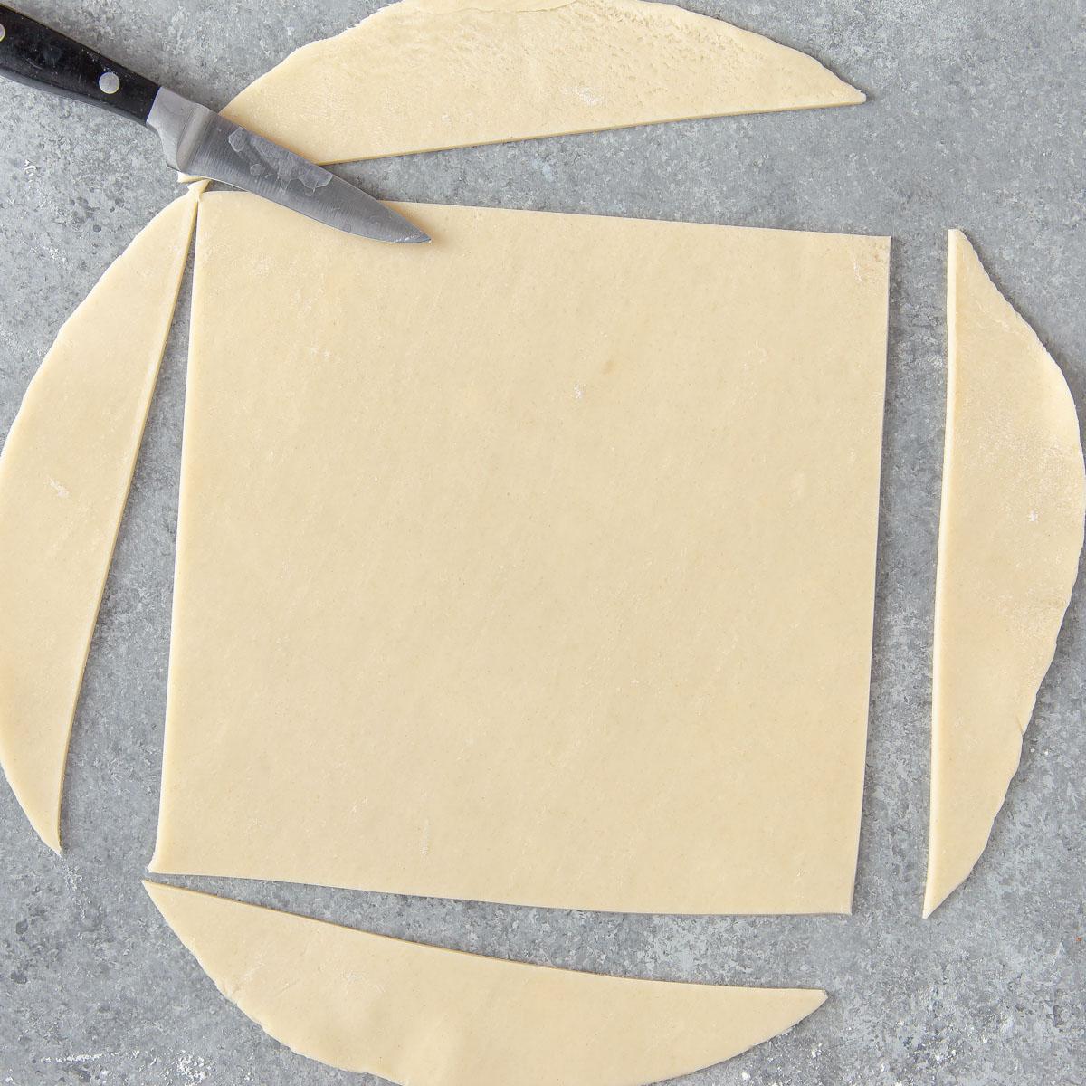 cutting a round pie crust into a square