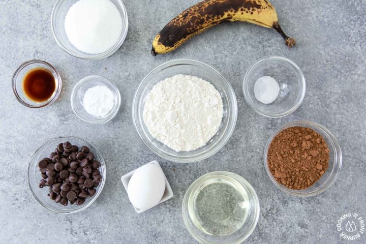 ingredients for chocolate chip banana muffins on a table