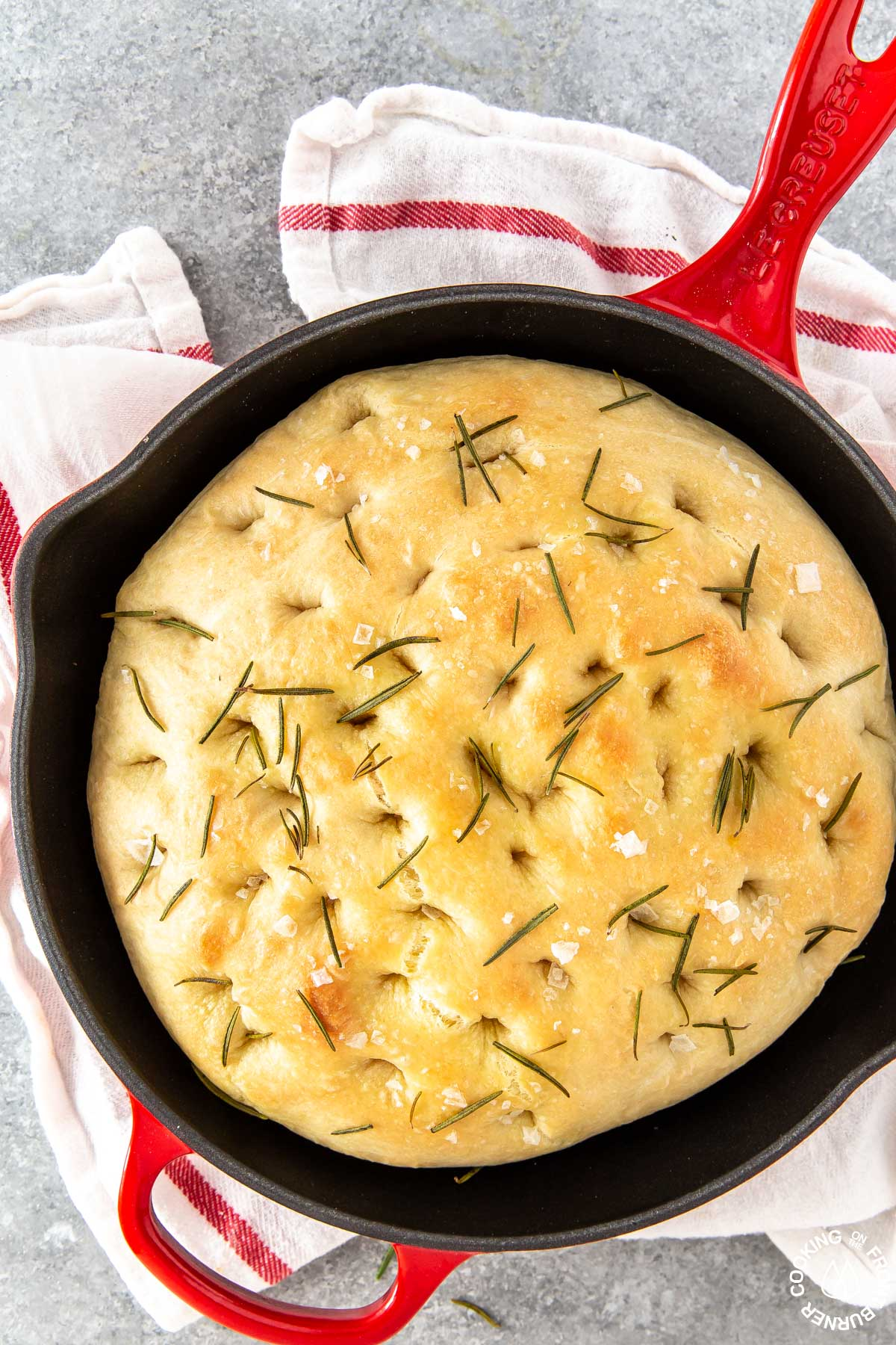 a skillet with baked focaccia bread