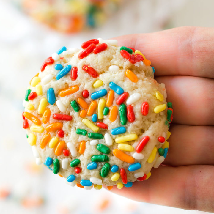 a chewy sprinkle cookie in a hand