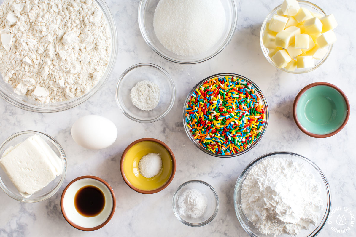 a table with all the ingredients needed for sprinkle cookies