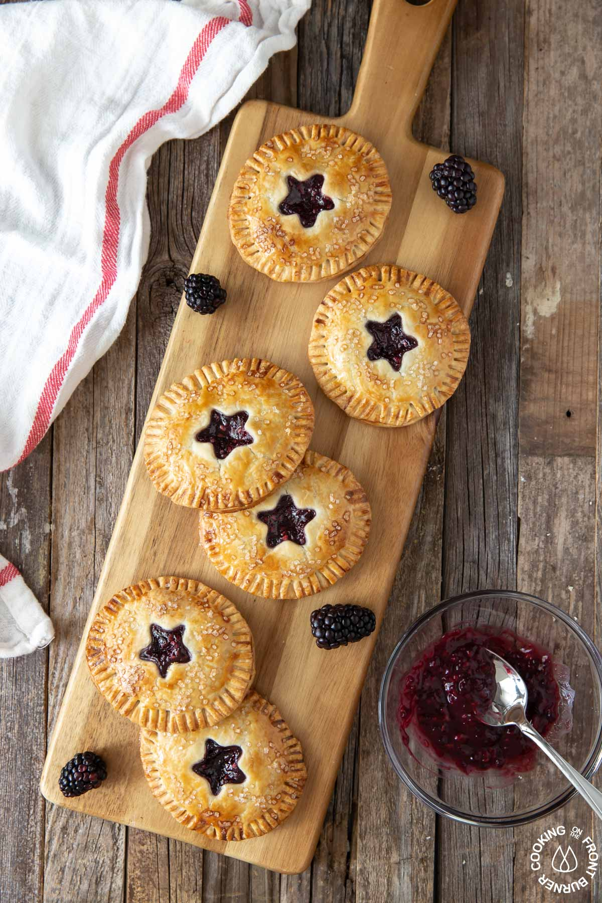 6 blackberry hand pies on a serving board