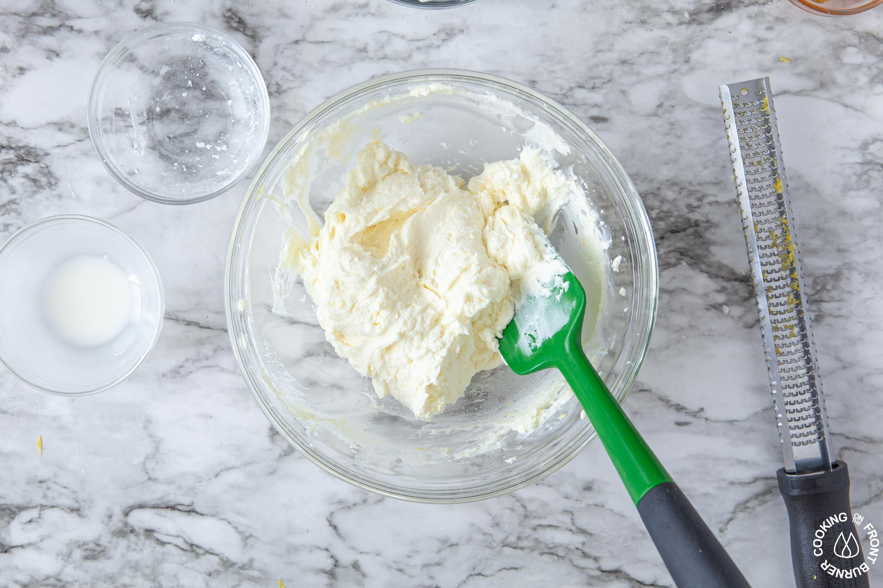 a bowl of creamy mascarpone cheese lemon filing