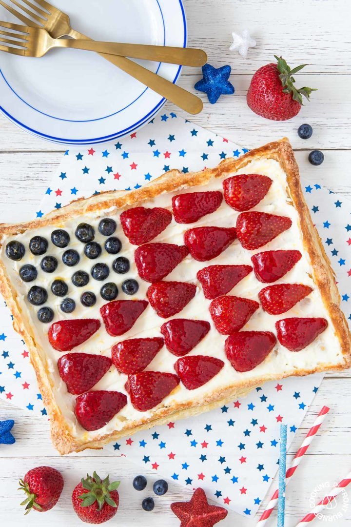 a puff pastry tart with berries arranged into an american flag
