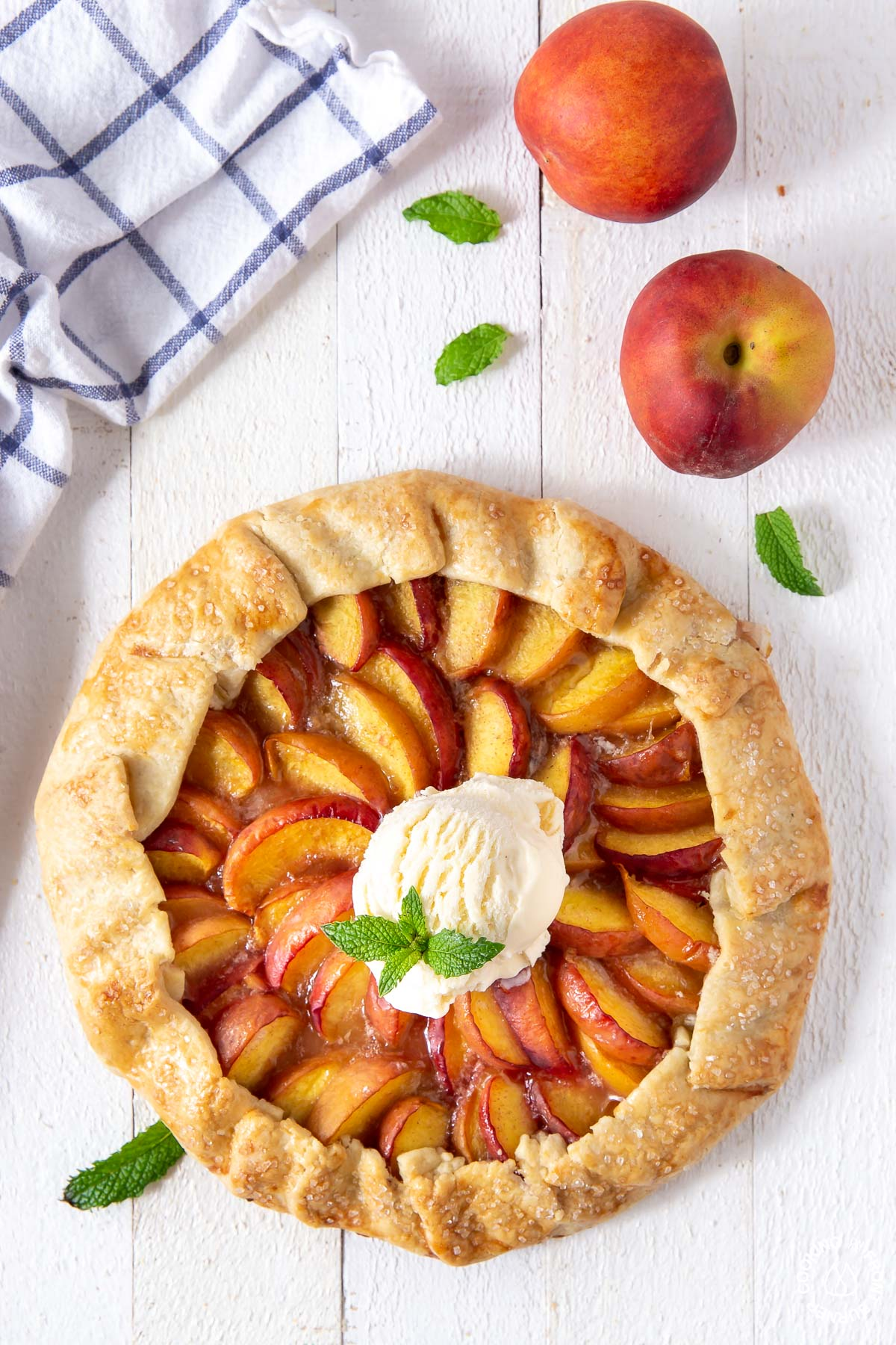 baked peach galette with vanilla ice cream on top