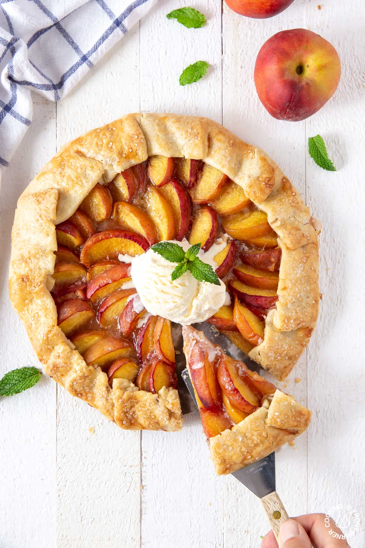 a peach galette with a slice cut out
